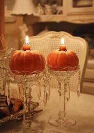 pumpkin candles on crystal candle holder